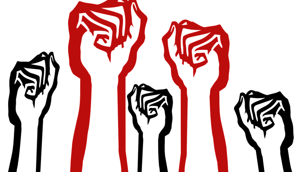 Drawing of five wadded fists held in the air. Two fists are red and three are black held together in a show of solidarity for drug user rights.
